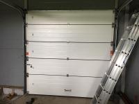 Гаражные подъёмно-секционные ворота Alutech Prestige в Соуранде