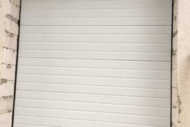 Ворота гаражные подъёмно-секционные Doorhan серии RSD02 в Васкелово фото 1 после