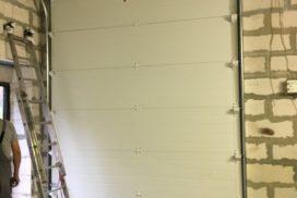 Ворота гаражные подъёмно-секционные Doorhan серии RSD02 в Васкелово фото 2 после