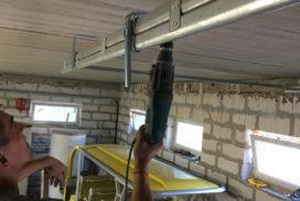 Ворота гаражные подъёмно-секционные Doorhan серии RSD02 в Васкелово фото 4 после