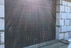 Ворота гаражные подъёмно-секционные DoorHan серии RSD02 в Новых Осельках фото 1 после