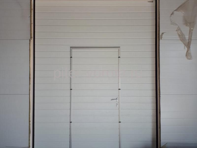 Промышленные подъёмно-секционные ворота Alutech Protrend в Лаголово
