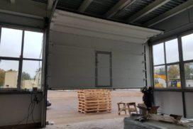 Промышленные подъёмно-секционные ворота DoorHan ISD01 в Отрадном, фото 2